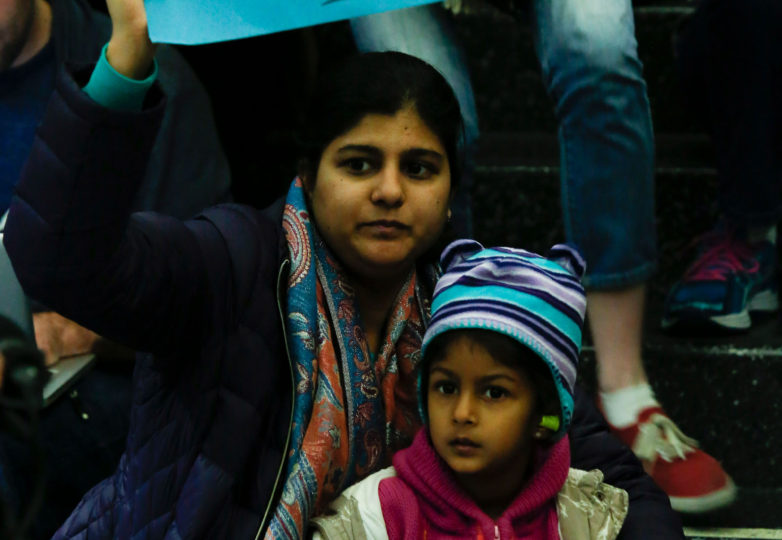 Shaheen Kanchwala and her daughter hold signs during a protest at the international terminal of San Francisco International Airport in San Francisco, Calif. Sunday, January 29, 2017 to draw attention to President Donald Trump latest executive order to deny citizens of seven Muslim-majority countries from entering the United States. Photo by Emma Marie Chiang