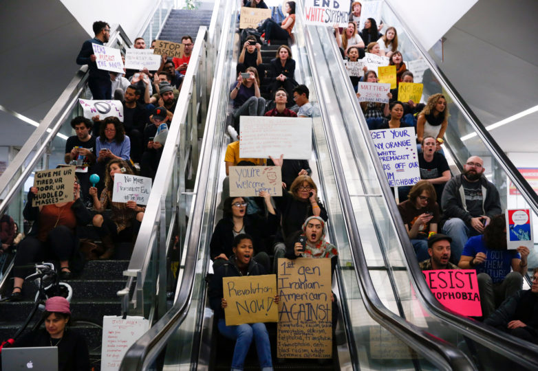 Protesters block escalators and stairs during a protest at the international terminal of San Francisco International Airport in San Francisco, Calif. Sunday, January 29, 2017 to draw attention to President Donald Trump latest executive order to deny citizens of seven Muslim-majority countries from entering the United States. Photo: Emma Marie Chiang