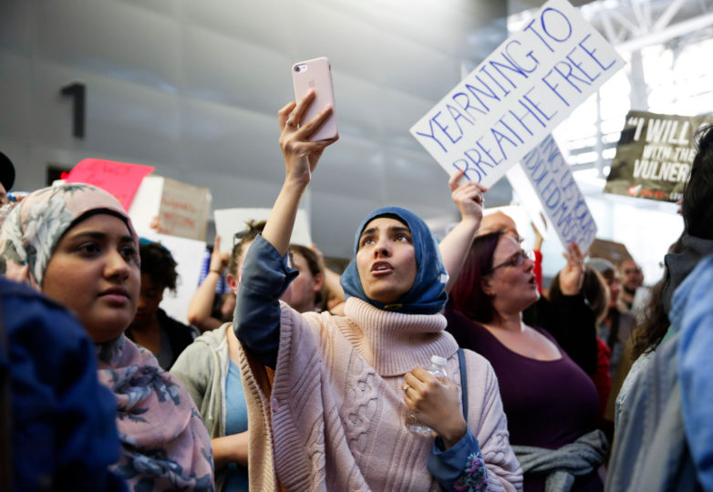 Saadia Razvi (middle) and Filza Mazahir (left) from Santa Clara participate in the protest at the international terminal of San Francisco International Airport in San Francisco, Calif. Sunday, January 29, 2017 to draw attention to President Donald Trump latest executive order to deny citizens of seven Muslim-majority countries from entering the United States. Photo by Emma Marie Chiang