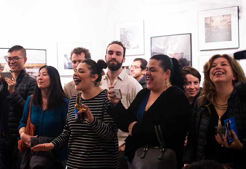 "Community members attend the ""4th Annual Latino Life"" photojournalism exhibit reception at Acción Latina on Saturday, Jan. 14. Photo: Beth LaBerge"