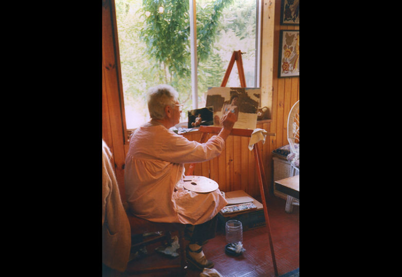 The author's mother, Elba Parra Guzmán, painting in Guaylandia, Chile, circa 2008. Courtesy: Carlos Barón