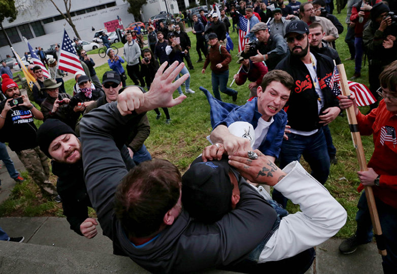A Trump supporter punches a restrained protester at a Pro Trump rally at Martin Luther King Jr. Civic Center Park  on Saturday, March 4, 2017 in Berkeley, Calif. 10 people were arrested after numerous clashes between supporters and protesters. Photo: Gabriella Angotti-Jones