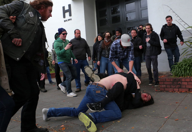 A Trump supporter and protester clash after supporters attempted to march outside of  Martin Luther King Jr. Civic Center Park  on Saturday, March 4, 2017 in Berkeley, Calif. 10 people were arrested after numerous clashes between supporters and protesters. Photo: Gabriella Angotti-Jones