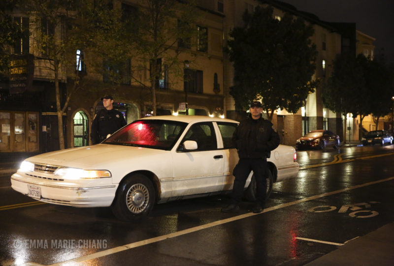 Two police officers block off 17th Street as a group of demonstrators block off 17th and Valencia streets in front of the Mission Police Station in response to the District Attorney's office statement to not indict the officers involved in the fatal shooting of Amilcar Perez-Lopez in February 2015 on Wednesday April 12, 2017. Photo: Emma Marie Chiang