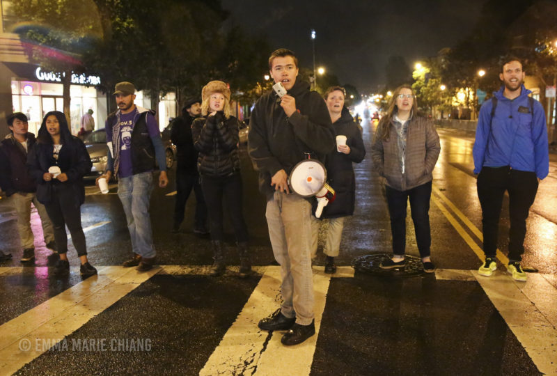 Michael Picasso leads a small group of demonstrators in a chant. Photo: Emma Marie Chiang