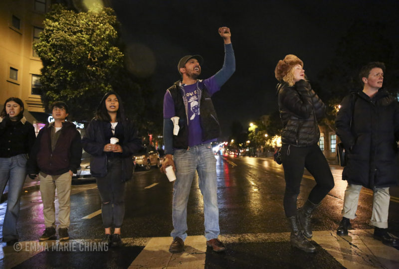 Jeremy Miller raises his fist and chants with other demonstrators. Photo: Emma Marie Chiang