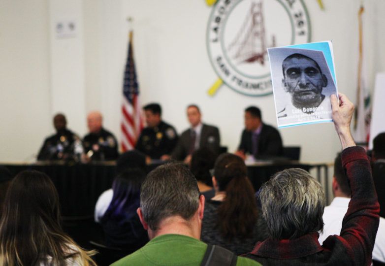 Frank Sosa, a member of the Anti Police-Terror Project, holds a sign with the portrait of Luis Góngora Pat during a town hall meeting on April 13 held at Laborers' Local 261 addressing the fatal shooting of Góngora by SFPD. Góngora, a homeless man, was shot by SFPD on Shotwell Street between 18th and 19th streets on April 7. Photo Joel Angel Juarez