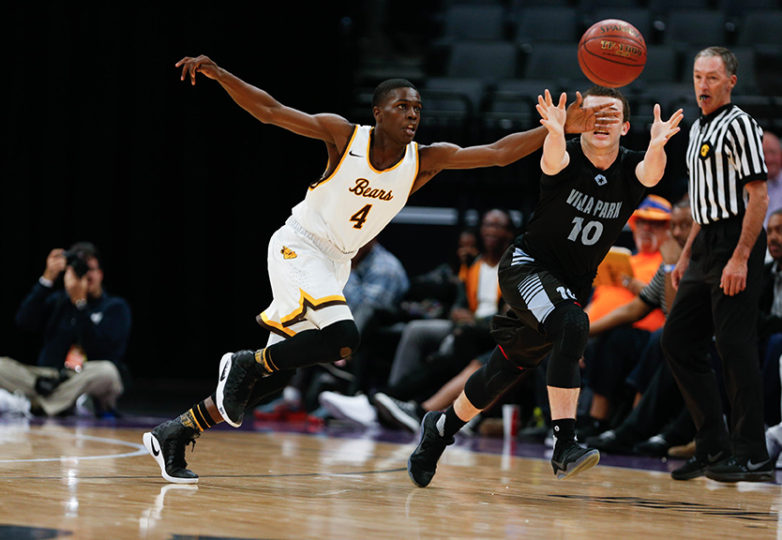 Mission Bears guard Tyrese Johnson (4) defends Villa Park guard Caleb Banuelos (10) as the Mission Bears take on the Villa Park Spartans in the 2017 CIF Division III State Basketball Championships at the Golden 1 Center in Sacramento, Calif., on Friday, March 24, 2017. Photo: Scot Tucker/SFBay.ca