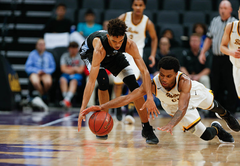 Mission Bears guard Niamey Harris (21) and Villa Park guard Myles Franklin (13) battle for the ball as the Mission Bears take on the Villa Park Spartans in the 2017 CIF Division III State Basketball Championships at the Golden 1 Center in Sacramento, Calif., on Friday, March 24, 2017. Photo: Scot Tucker/SFBay.ca