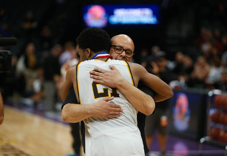 Mission Bears head coach Arnold Zelaya and Mission Bears guard Niamey Harris (21) embrace after the win as the Mission Bears take on the Villa Park Spartans in the 2017 CIF Division III State Basketball Championships at the Golden 1 Center in Sacramento, Calif., on Friday, March 24, 2017. Photo: Scot Tucker/SFBay.ca
