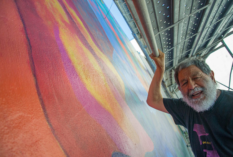 Muralist Carlos Loarca poses for a portrait at the site of the Mission Cultural Center Mural Restoration. Photo: Mabel Jiménez
