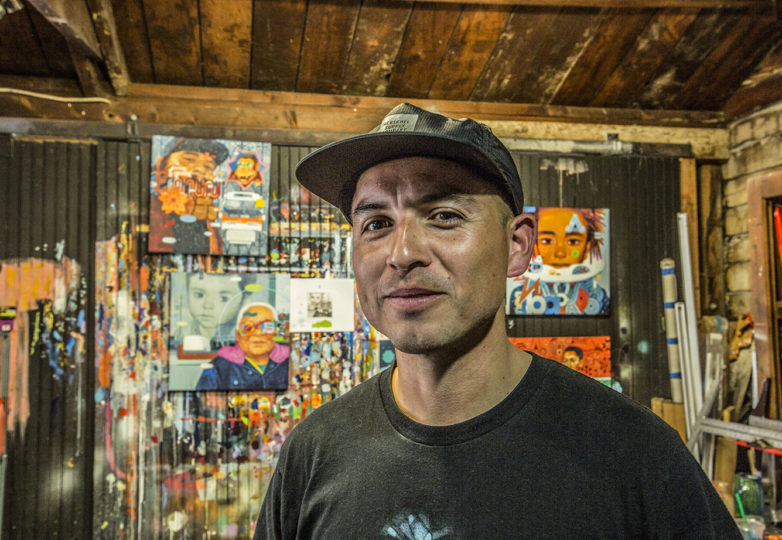 """Artist Sam Rodriguez poses for a portrait on May 12 in his San Jose studio, where he's been creating work for his upcoming """"Caras de la Misión"""" exhibition at the Juan R. Fuentes Gallery. Photo: Jean Melesaine"""