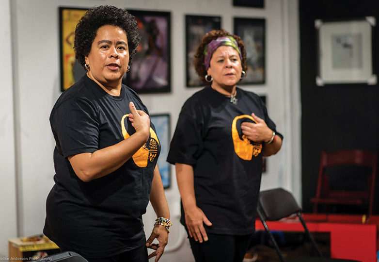 Melissa Cardoza and Karla Lara at a musical and poetry performance at SoleSpace Oakland on May 4, during an event to honor Berta Caceres, the Honduran environmental activist who was killed for her work. Photo: Brooke Anderson