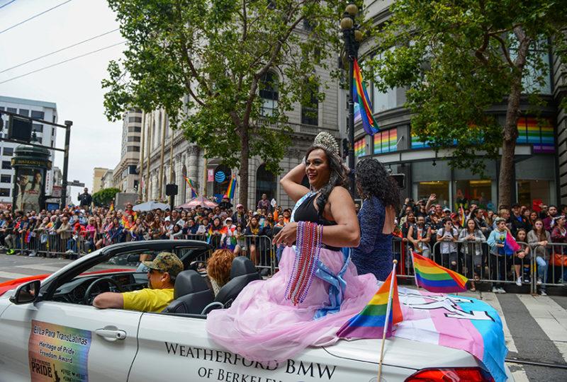 Yuritza Hernandez, Miss El/La 2017, throws beads to the crowd at the San Francisco Pride parade. Photo: Desiree Rios