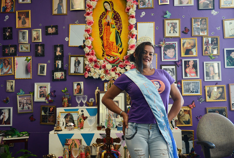 Yuritza Hernandez, Miss El/La 2017, poses for a photo in front of an altar at the El/La Para TransLatinas office on Friday, June 23. Photo: Desiree Rios