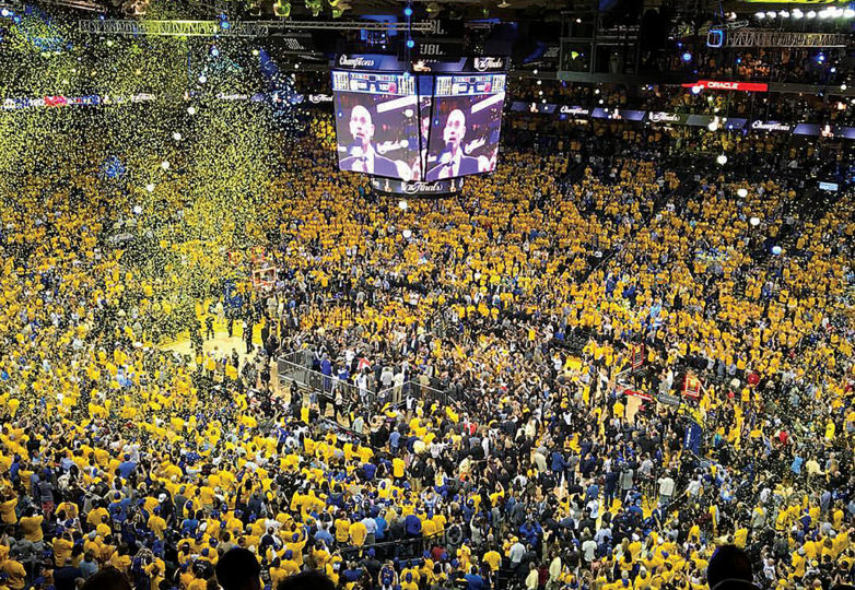 Fans at Oakland's Oracle Arena celebrate as the Golden State Warriors win their second NBA title in three years after defeating the Cleveland Cavaliers on June 12. Photo: Briane Fernandez Nuval