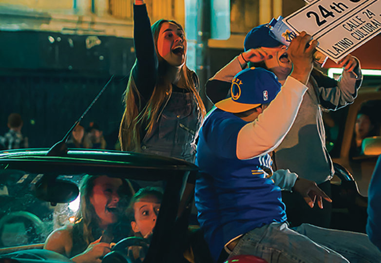 Golden State Warriors fans party on Mission Street following the team's victory over the Cleveland Cavaliers in the 2017 NBA Finals on June 12. Photo: Lisette Wijnen/@kuifjeinamerika