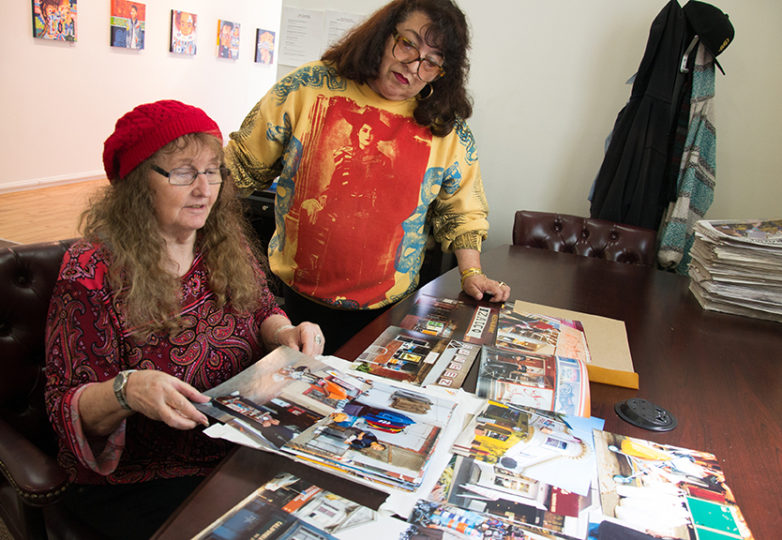 "Linda Wilson and Cindy De Losa, co-curators of the upcoming ""Back in the Day: A Collective Memory of 24th Street"" exhibit, review prints that will be exhibited in the show, which opens Aug. 12 at Acción Latina's Juan R. Fuentes Gallery. Photo: Mabel Jiménez"