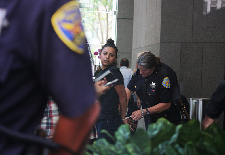 Sandy, the California Immigrant Youth Justice Alliance's statewide coordinator, is arrested on July 30, 2015 for refusing to leave the lobby at 1 Post St. Photo: Alexis Terrazas