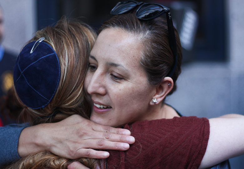 Yadira Munguia embraces Rabbi Elana Rosen-Brown of the Congregation Rodef Shalom, outside the USCIS field office at 630 Sansome St. in San Francisco on June 20, 2017, where a rally was held in support of Munguia's detained husband, Hugo Mejia. Photo: Alexis Terrazas