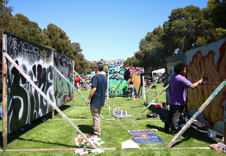 The event scattered makeshift canvases throughout the park, where kids and teens painted. Photo: Erica Marquez.