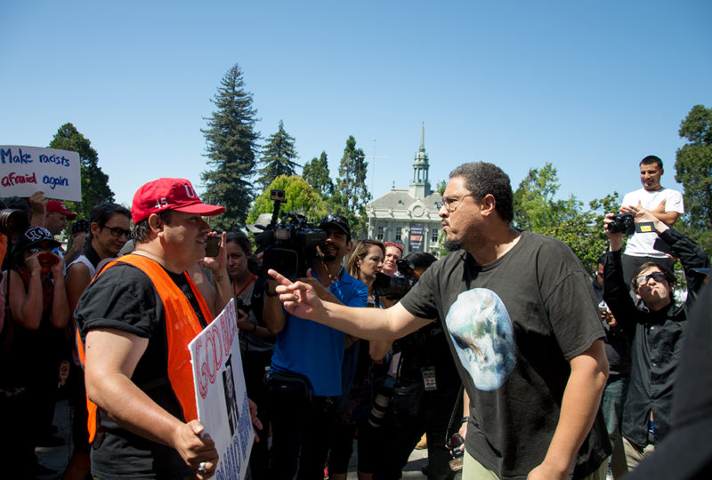 A Trump supporter (left) is confronted by a counter demonstrator at Berkeley's MLK Civic Center on Sunday August 27, 2017. Photo: Mabel Jimenez