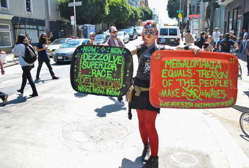 A demonstrator holds anti-fascist signs at the corner of Hayes and Fillmore streets, a block away from Alamo Square Park where right-wing group 'Prayer Patriot' were shut down by police from having a news conference on Saturday, Aug. 26, 2017. Photo: Alejandro Galicia Diaz