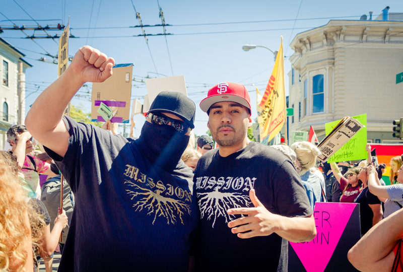 "Protesters wearing ""Mission"" t-shirts rally outside of Alamo Square Park in San Francisco on Saturday, August 26, 2017. Photo: Drago Renteria"