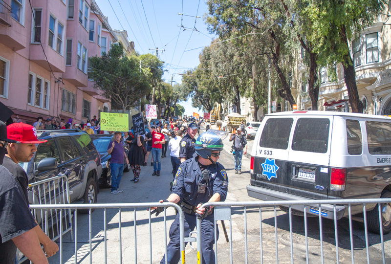 SFPD open a barricade to allow demonstrators to join a larger group of protesters gathered at the perimeter of Alamo Square Park on Saturday, August 26, 2017. Photo: Drago Renteria