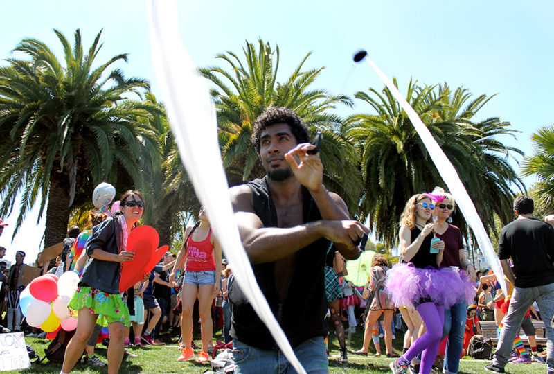"A man twirls scarf pois at the ""Loved Up"" counter dance rally in Mission Dolores Park, San Francisco, Calif. On August 26, 2017. Photo: Janett Perez"