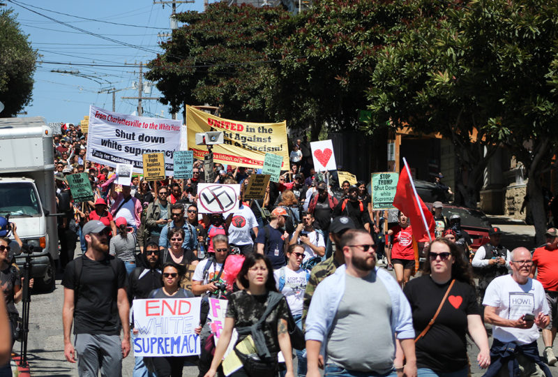Hundreds of counter-protestors march down Steiner Street to protest a planned right-wing rally at Alamo Square Park in San Francisco, Ca on August 26, 2017.  (Photo by: Jocelyn Carranza)