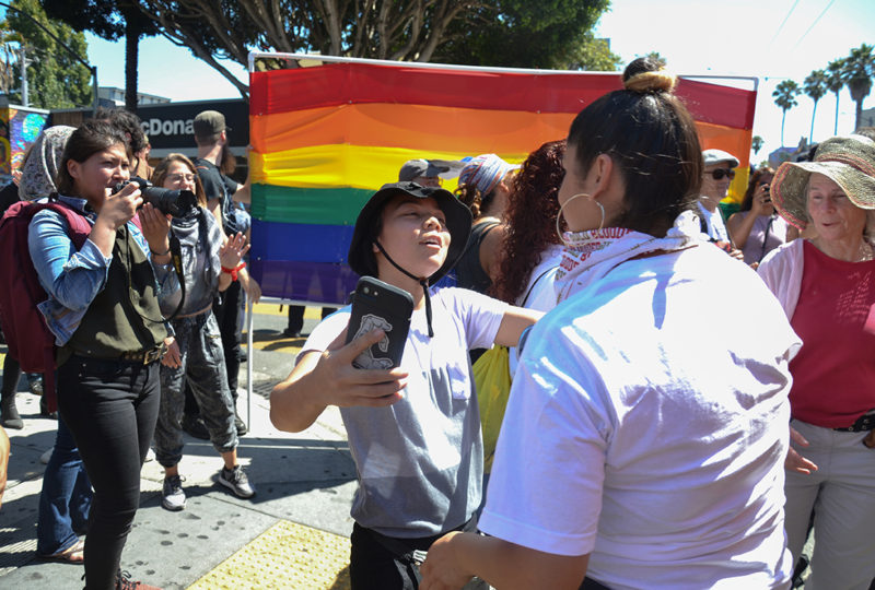 Anti-right wing demonstrators embrace each other at on 24th and Mission Streets during a counter protest against right-wing group Patriot Prayer, who cancelled an event earlier that day in Alamo Square, Saturday Aug. 26. Photo: Mabel Jimenez