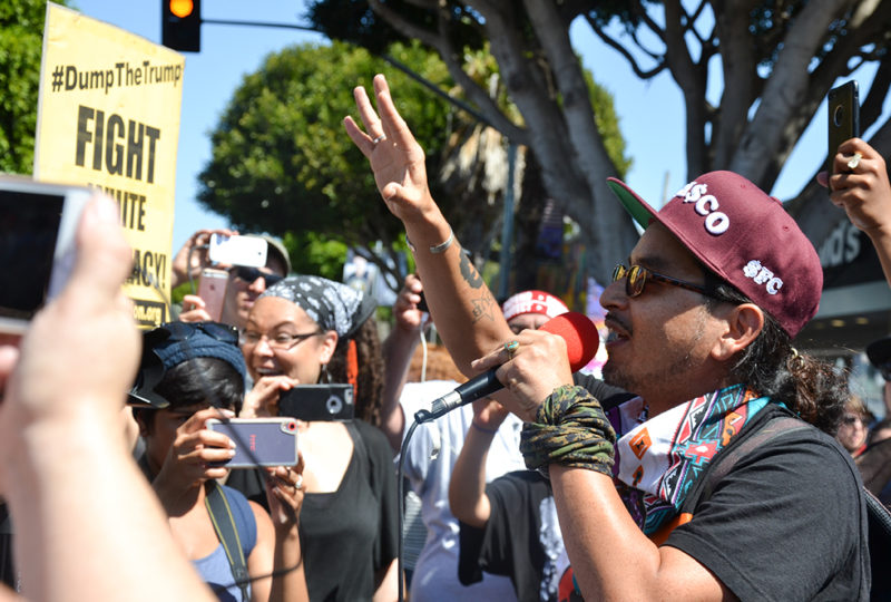 Rapper Equipto, from the Frisco 5 performs in front of a crowd of anti-right wing demonstrators gathered on 24th and Mission Streets, Saturday Aug. 26. Photo: Mabel Jimenez