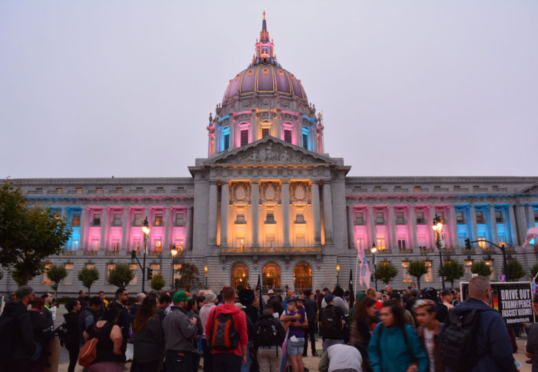 In response to Trump's threat to ban transgender people from the military, City Hall was illuminated with the colors of the transgender flag (pink, blue and white) on July 26, 2017. Photo: Jay Garcia