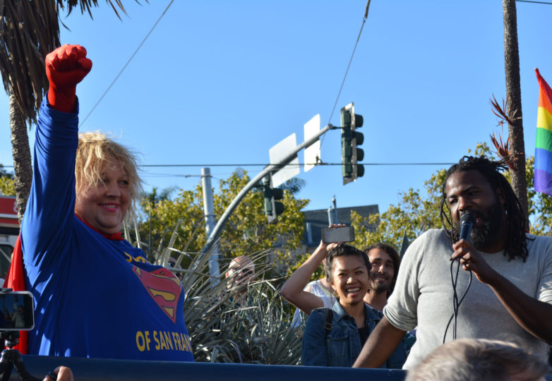 "A transgender woman dressed as Supergirl compares the Trump administration to Lex Luthor on July 26, 2017, as she chants ""Lex Luthor must go."" Photo: Jay Garcia"