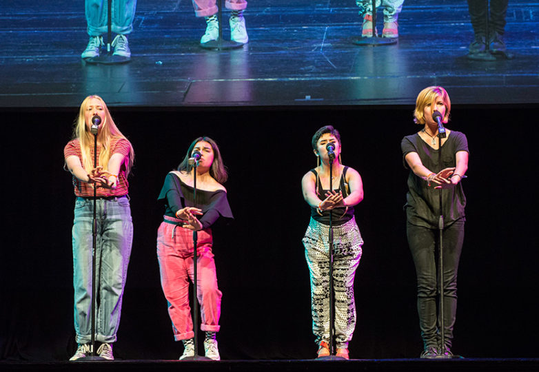 Liliana Perez (third from left) and members of Say Word, a youth poetry group from Pomona, CA, perform at the 2017 Brave New Voices Youth Poetry Slam Festival on July 22, 2017. Photo: Desiree Rios