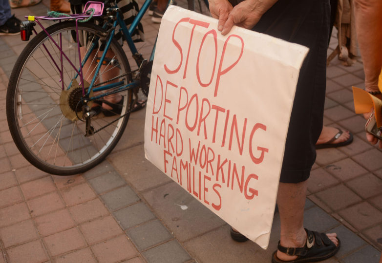 A supporter of DACA recipients holds a pro-immigration sign at an emergency vigil for DACA recipients at Frank Ogawa Plaza in Oakland, Calif. on Thursday, August 31, 2017.  The vigil was called amid reports that in the coming days, even as soon as tomorrow, President Donald Trump will end the DACA program. Photo: Aaron Levy-Wolins