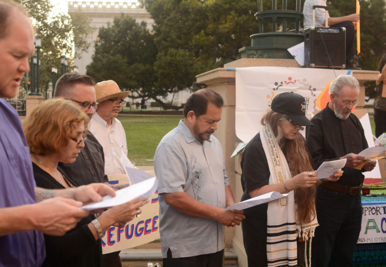 Religious leaders and followers lead prayers for DACA recipients and all immigrants at an emergency vigil for DACA recipients at Frank Ogawa Plaza in Oakland, Calif. on Thursday, August 31, 2017.  The vigil was called amid reports that in the coming days, even as soon as tomorrow, President Donald Trump will end the DACA program. Photo: Aaron Levy-Wolins