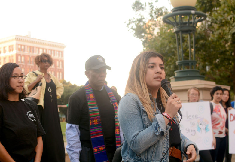 Talissa Carrasco, 27, a Board of Immigrations (BIA) representative at Catholic Charities of the East Bay and a DACA recipient who lives in Richmond, Calif. and is originally from Peru, speaks at an emergency vigil for DACA recipients at Frank Ogawa Plaza in Oakland, Calif. on Thursday, August 31, 2017.  The vigil was called amid reports that in the coming days, even as soon as tomorrow, President Donald Trump will end the DACA program. Photo: Aaron Levy-Wolins