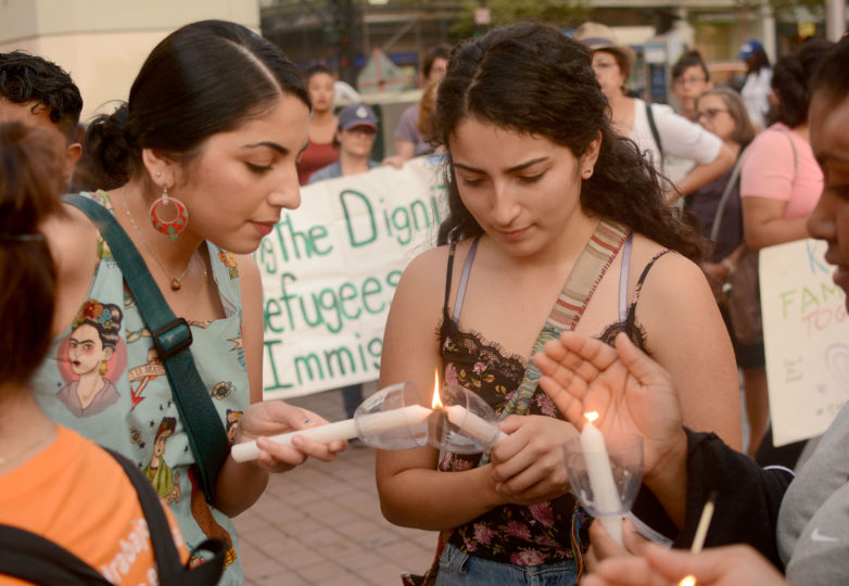 DACA recipient sisters Mayra Alcaraz (left), 24, a civil engineering student from Fremont, Calif., and Daniela Alcaraz (right), 18, an undecided major from Fremont, light candles with other recipients at an emergency vigil for DACA recipients at Frank Ogawa Plaza in Oakland, Calif. on Thursday, August 31, 2017.  The vigil was called amid reports that in the coming days, even as soon as tomorrow, President Donald Trump will end the DACA program. Photo: Aaron Levy-Wolins