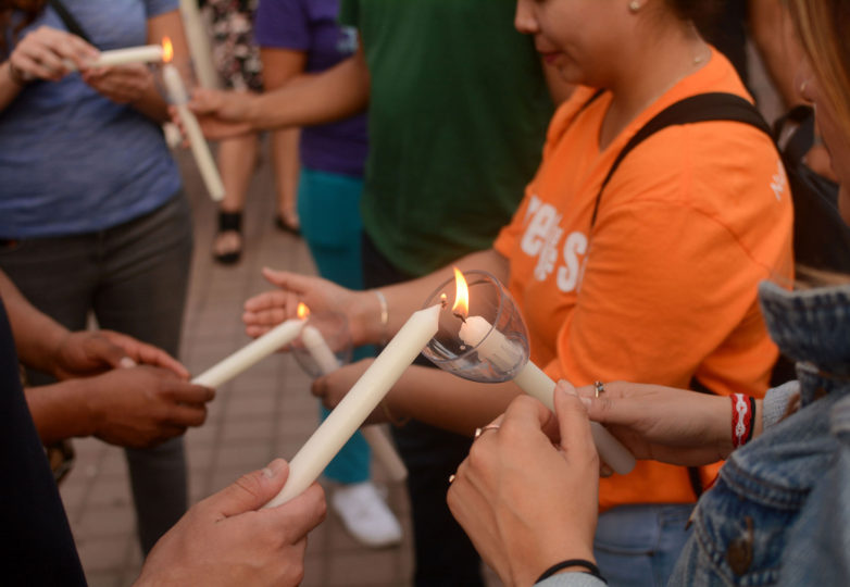 DACA recipients light candles at an emergency vigil for DACA recipients at Frank Ogawa Plaza in Oakland, Calif. on Thursday, August 31, 2017.  The vigil was called amid reports that in the coming days, even as soon as tomorrow, President Donald Trump will end the DACA program. Photo: Aaron Levy-Wolins