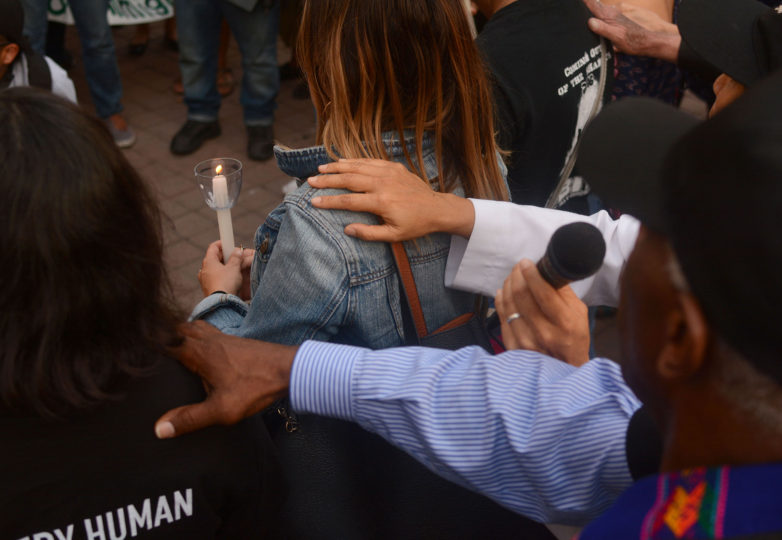 Supporters put their hands on the shoulders of DACA recipients at an emergency vigil for DACA recipients at Frank Ogawa Plaza in Oakland, Calif. on Thursday, August 31, 2017.  The vigil was called amid reports that in the coming days, even as soon as tomorrow, President Donald Trump will end the DACA program. Photo: Aaron Levy-Wolins