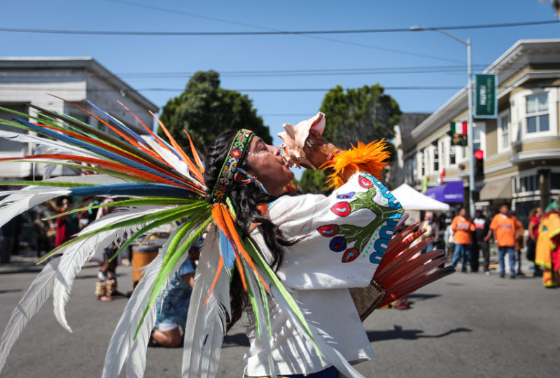Danza Azteca Xitlalli dance group performs during the Calle 24 Fiesta de las Américas festival grand opening on 24th and Harrison Streets in San Francisco's Mission District on Sunday, Sept. 17, 2017. (Photo by Ekevara Kitpowsong)