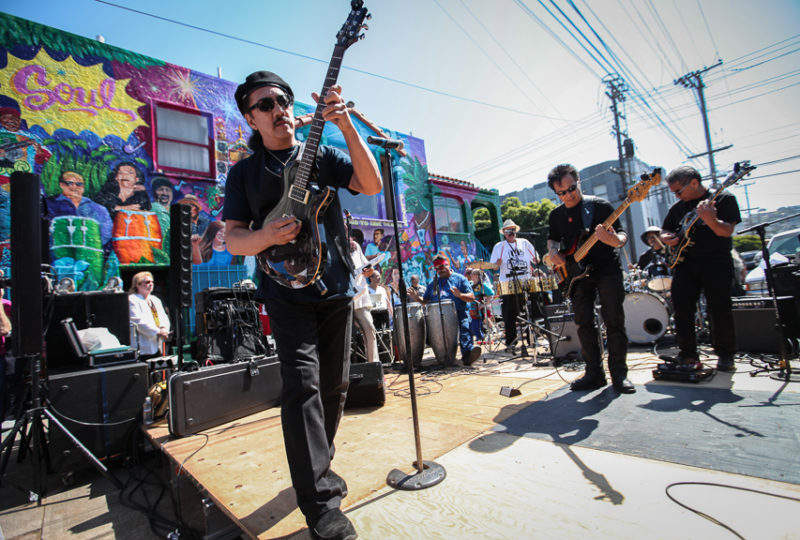 Dakila performs at the Latin Rock Stage at 25th and York Streets