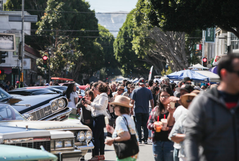 Huge crowds of people fill 24th Street in the Mission District d