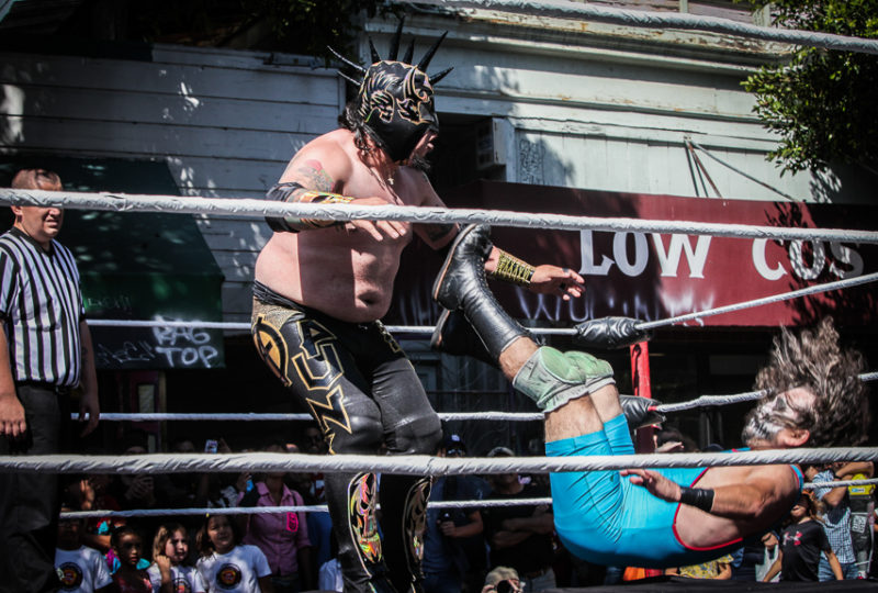 Lucha Libre wrestlers Curandero Cavernicola and Mr. Punk fight i