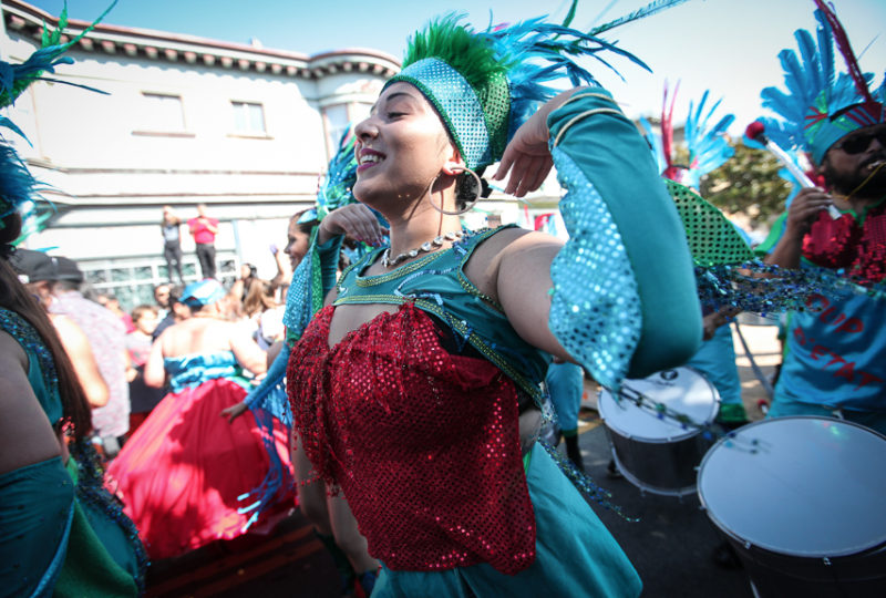 Fogo Na Roupa performers dance  at the Rumba Stage on 24th and H