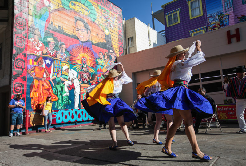 Performers dance in front of House of Breaks on 24th Street duri