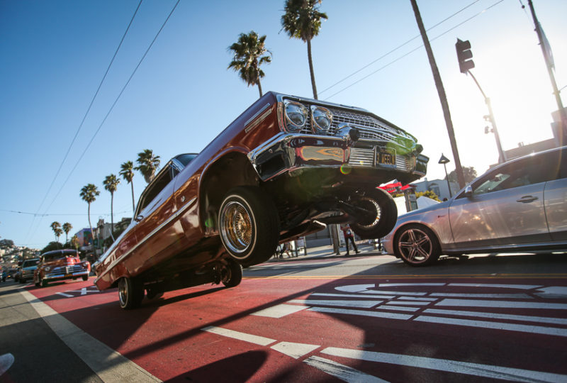 Lowriders cruise down Mission Street during the Calle 24 Fiesta