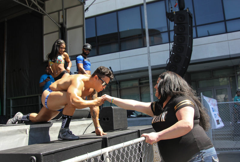 A dancer accepts a tip from an audience member at the Latinx Stage of Oakland Pride Festival, Sep. 10th. Photo: Adelyna Tirado